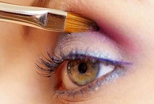 getty_rm_photo_of_woman_applying_bright_eye_shadow